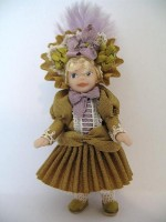 Toy Doll in Antique Old Gold Silk Dress